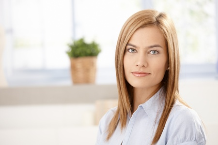 Portrait of attractive young woman front of window. Stock Photo - 8398057