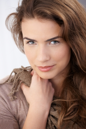 looking away from camera: Portrait of beautiful young woman smiling.