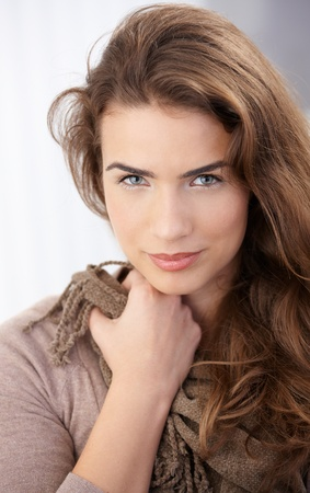 Portrait of pretty young woman smiling at home. photo