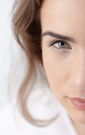 Closeup half portrait of beautiful young woman. Stock Photo - 8534650