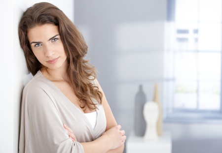 Portrait of beautiful young female smiling at home photo