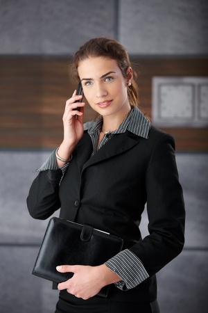 Attractive young businesswoman talking on mobile phone. photo
