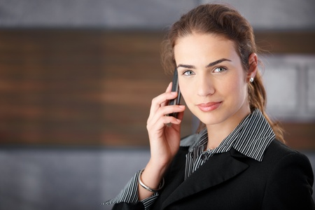 Attractive young businesswoman using cellphone. photo
