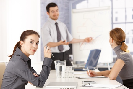 Attractive female sitting at meeting room, listening to presentation. Stock Photo - 8556735