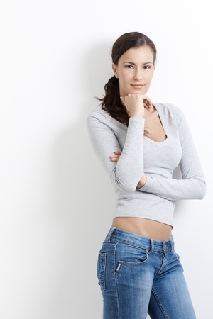 Sexy female standing arms crossed over white background. Stock Photo - 8553303