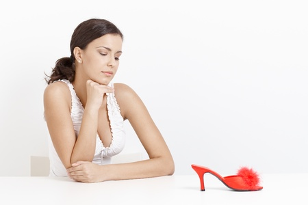 Portrait of attractive young girl with high heel red slippers. photo