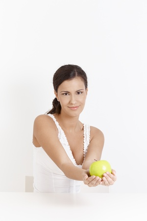 Attractive young girl smiling, holding an Apple in her hands Stock Photo - 8557397