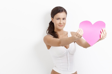 Amorous young female holding paper heart, smiling happily. Stock Photo - 8553099
