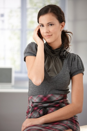 Young attractive woman chatting on mobile at home. photo