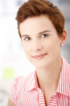 Closeup portrait of redhead woman smiling at camera. Stock Photo - 8557572