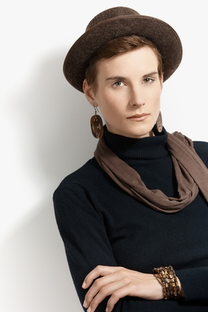Portrait of trendy woman wearing hat and scarf. Stock Photo - 8553362
