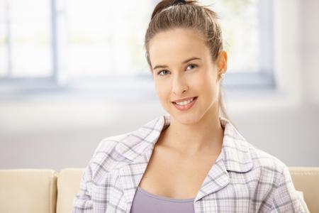Morning portrait of smiling woman in pyjama on sofa. Stock Photo - 8604085