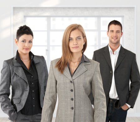 three color: Portrait of young and confident business team posing in office.