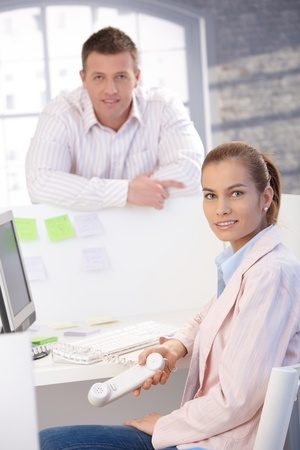 Happy casual office workers smiling in bright office. Stock Photo - 8747077