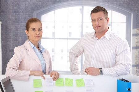 Casual office workers standing in bright office. photo