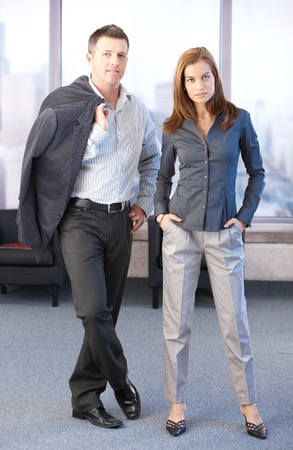 Young attractive businesspeople standing in office lobby. photo