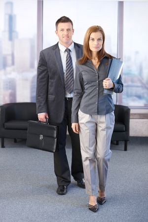 Manager and assistant going to business meeting, smiling. Stock Photo - 8747136