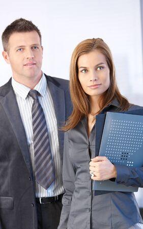 Portrait of attractive businesswoman and handsome businessman. photo