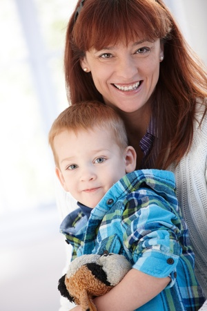 Portrait of happy mother and son at home. Stock Photo - 8747135
