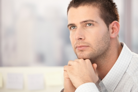 daydreaming: Portrait of handsome man thinking.