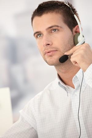 Portrait of handsome dispatcher working. photo