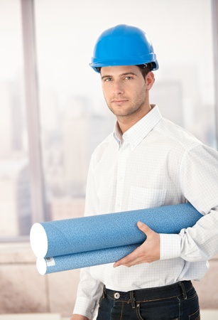 stubbly: Handsome young architect wearing hardhat. Stock Photo