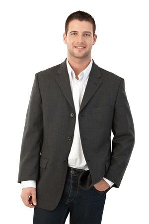 iş adamı: Young man smiling, hand in pocket. Stok Fotoğraf