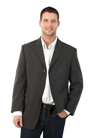 Young man smiling, hand in pocket. Stock Photo