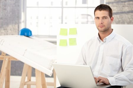 Handsome young man working in engineering office. Stock Photo - 8747231