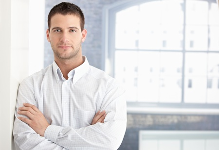 crossed arms: Goodlooking young man standing arms crossed.