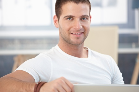 only 1 man: Portrait of handsome man smiling at home. Stock Photo