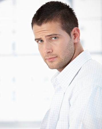 offish: Portrait of handsome young man in shirt in the morning.