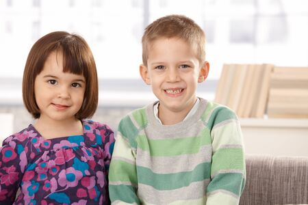 Portrait of cute small kids smiling at camera. photo