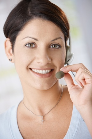 Closeup portrait of attractive woman talking on headset, holding on to microphone. Stock Photo - 8747576