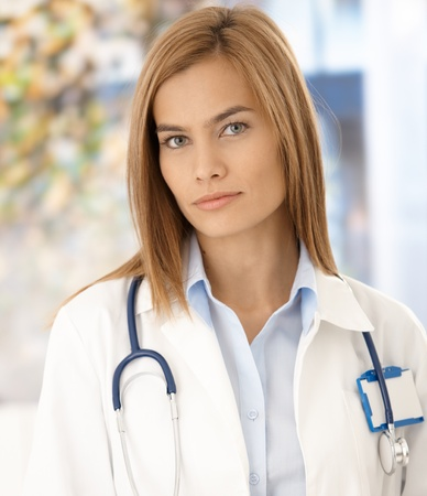 color consultant: Portrait of attractive young medical student in hospital. Stock Photo