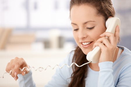 Portrait of attractive young woman talking on phone, smiling. Stock Photo - 8747493