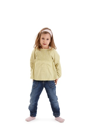 Studio portrait of small girl standing, looking at camera. Stock Photo - 8747681