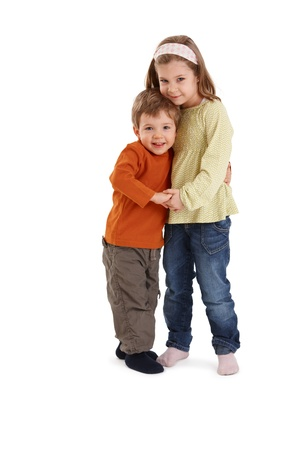 Portrait of happy siblings hugging each other, smiling at camera. photo
