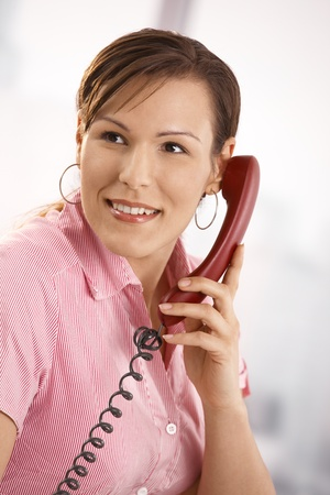 Closeup portrait of casual office worker talking on phone, smiling. Stock Photo - 8748752