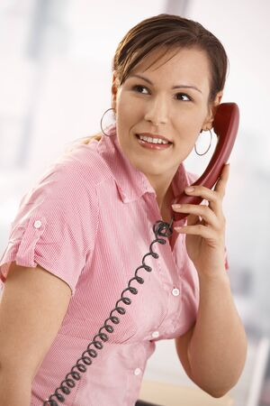 Closeup portrait of casual businesswoman talking on phone, smiling. Stock Photo - 8748765