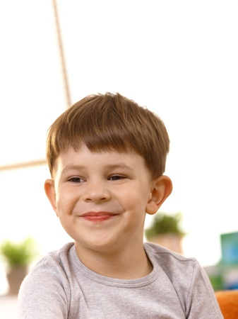age 5: Closeup portrait of five year old kid smiling happily. Stock Photo