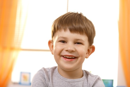 Portrait of adorable small boy looking at camera. photo