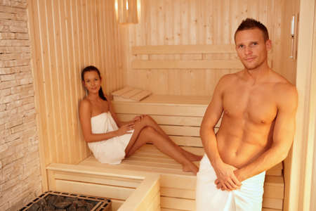 Portrait of couple in sauna on wellness weekend, smiling at camera. Stock Photo - 8753309