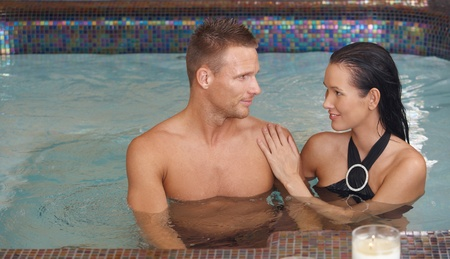 couples therapy: Smiling couple relaxing together in spa, enjoying wellness.