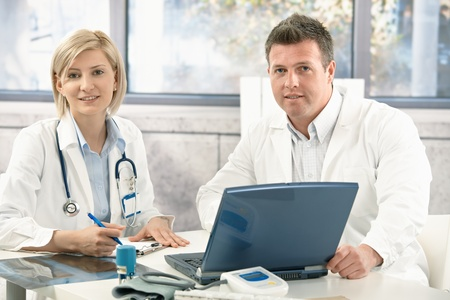 Portrait of medical doctors working together in office. photo
