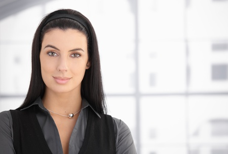 Closeup portrait of attractive woman with dark hair, smiling at camera. Stock Photo - 8782681