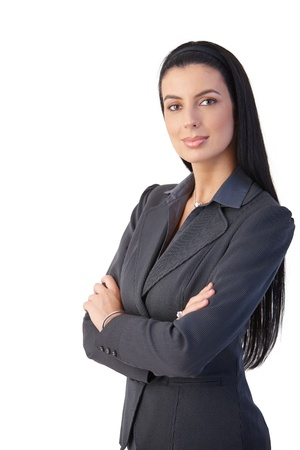 Pretty businesswoman posing with arms crossed, photo