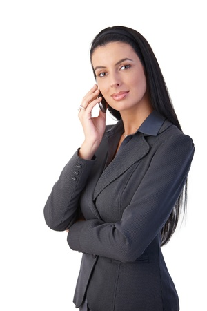 Confident smart businesswoman on mobile phone call, smiling at camera. photo