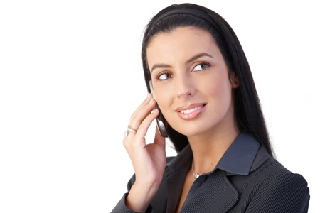 Happy businesswoman concentrating on cellphone call, smiling.