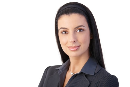 Closeup portrait of cheerful attractive businesswoman, smiling confidently. photo